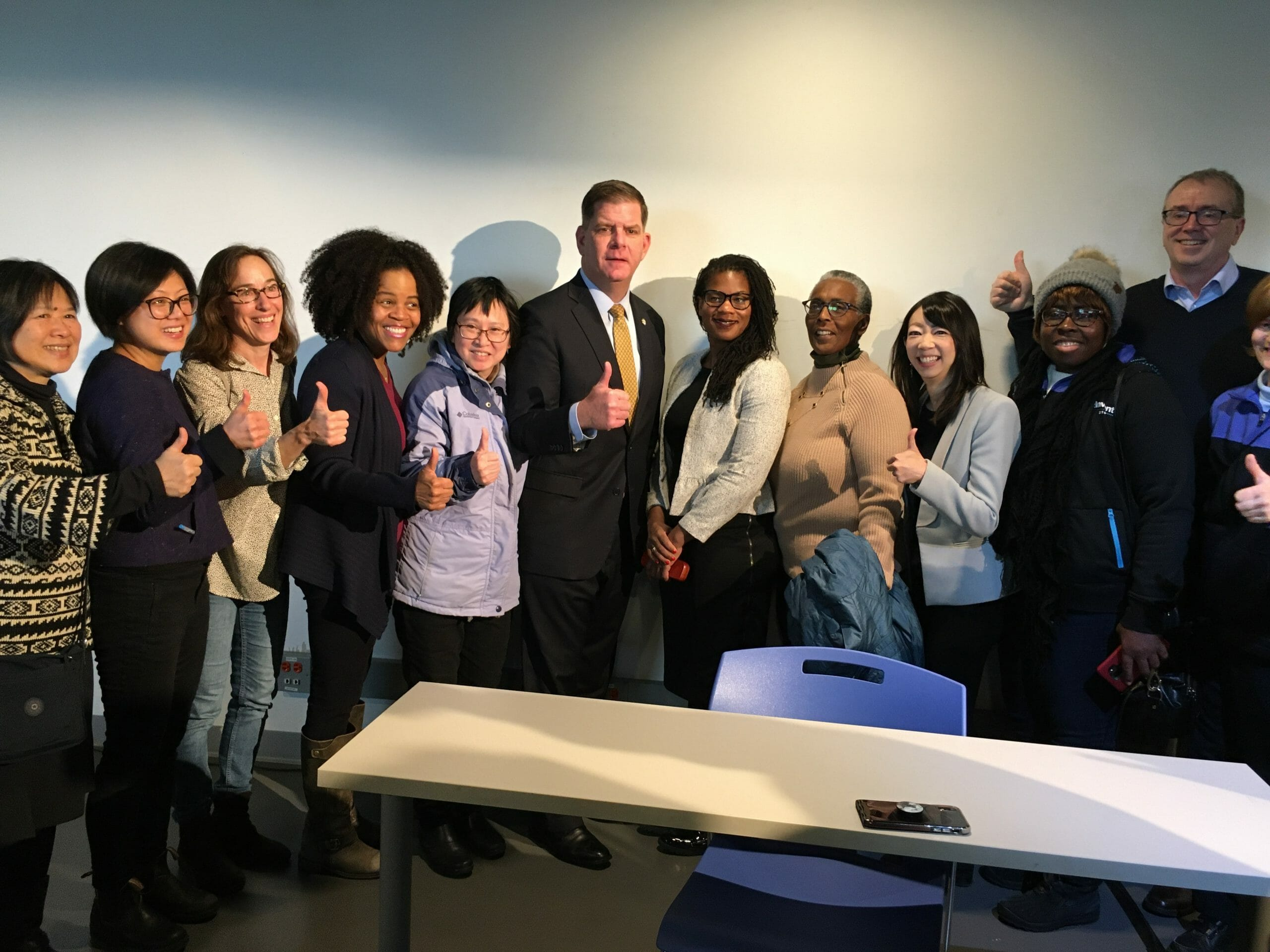 Mayor Walsh with housing advocates and lead sponsors.